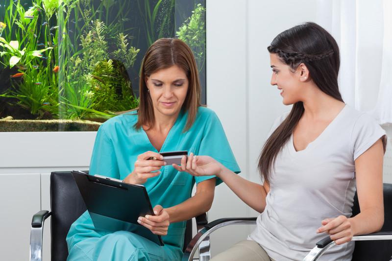 Woman paying medical bills